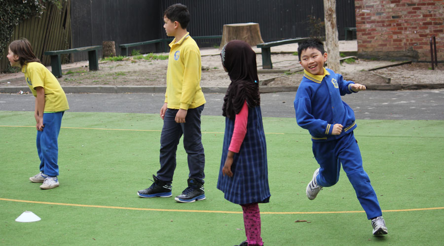 Students running during a Netball Schools program
