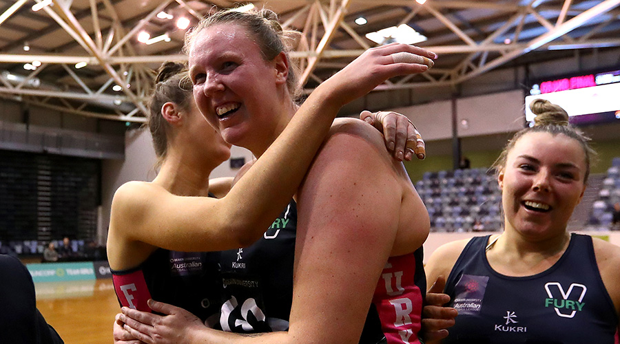 Emma Ryde celebrates with her Victorian Fury teammates after their Australian Netball League victory