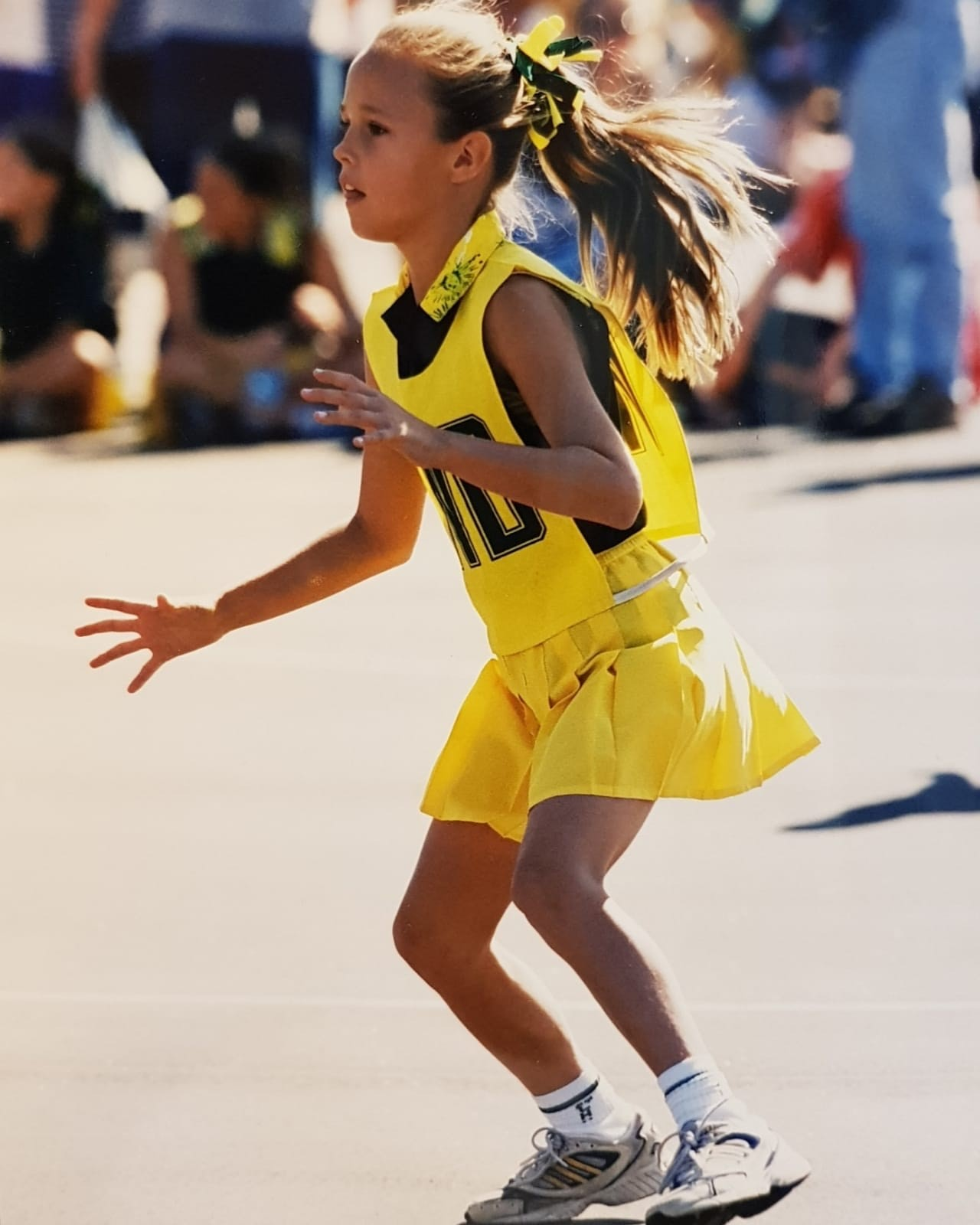 A young Paige Hadley playing netball.