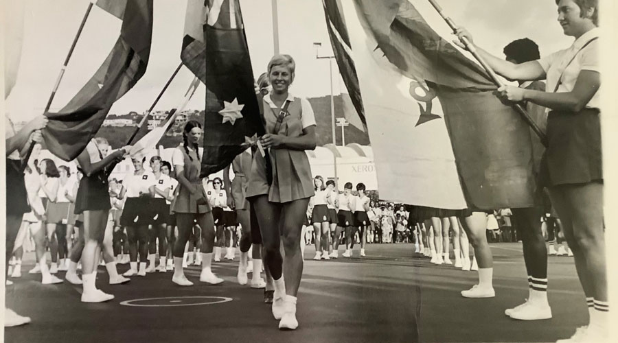 Australian captain, Gaye Teede carrying Australian flag through victory arch in Jamica.